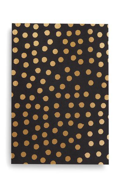 Oferta de Cuaderno B5 negro y dorado con estampado de puntos por 2,5€