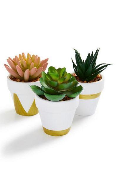 Oferta de Macetero de cerámica blanco en miniatura con flores sintéticas por 1,5€