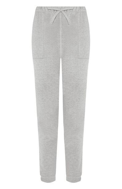 Oferta de Pantalón de chándal pitillo gris claro por 10€