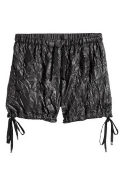 Oferta de Pantalón corto de nailon por 12,99€