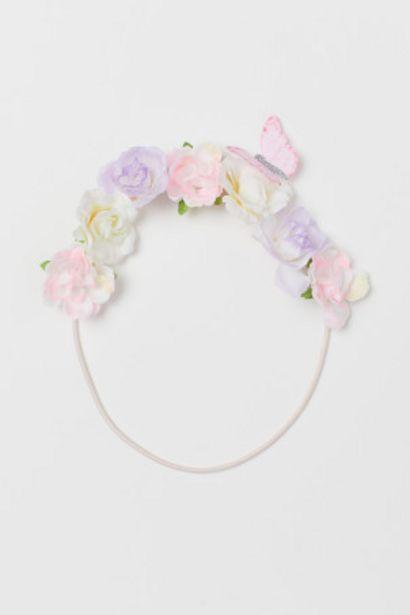 Oferta de Cinta de pelo con flores por 1,99€