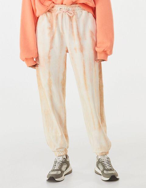 Oferta de Pantalón jogger felpa tie dye por 19,99€