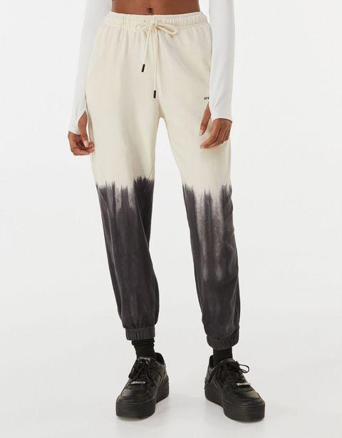 Oferta de Pantalón jogger felpa tie dye contraste por 22,99€