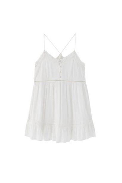 Oferta de Vestido blanco cortes puntilla por 19,99€