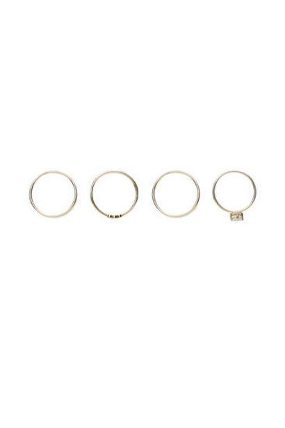 Oferta de Pack 4 anillos circonitas bañados en oro por 19,99€