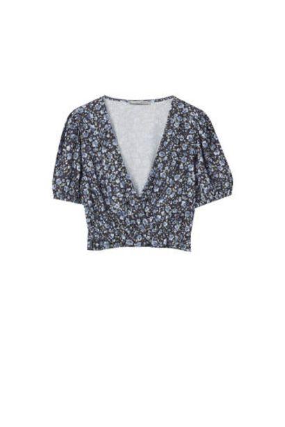 Oferta de Blusa estampada escote cruzado por 12,59€