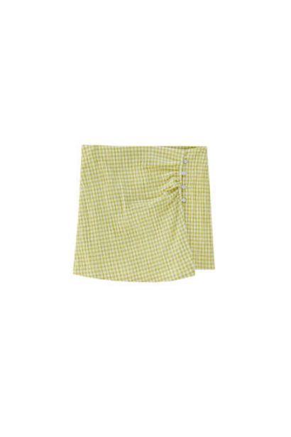 Oferta de Falda pantalón vichy botones por 17,99€