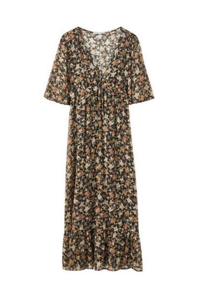 Oferta de Vestido escote pico volante pecho por 29,99€