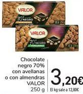 Oferta de Chocolate negro 70% con avellanas o con alemendras VALOR  por 3,2€