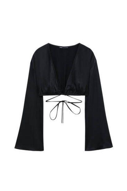 Oferta de Blusa satinada detalle cordones por 19,99€