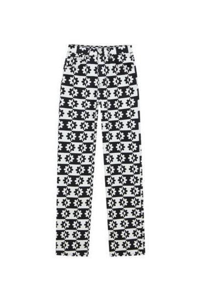 Oferta de Jeans rectos print blanco y negro por 25,99€