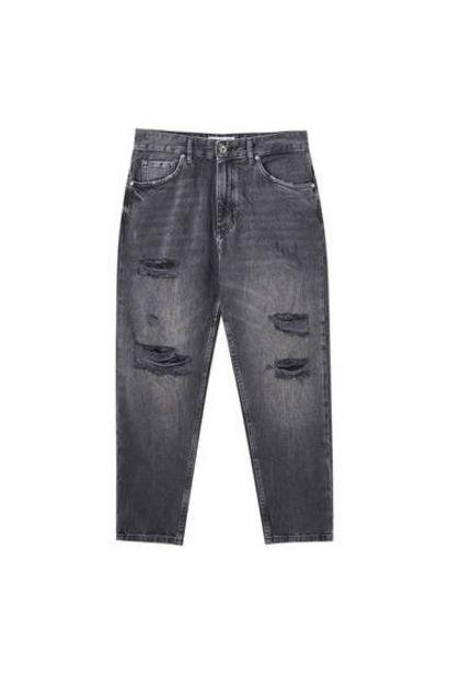 Oferta de Jeans relaxed fit rotos pernera por 7,99€