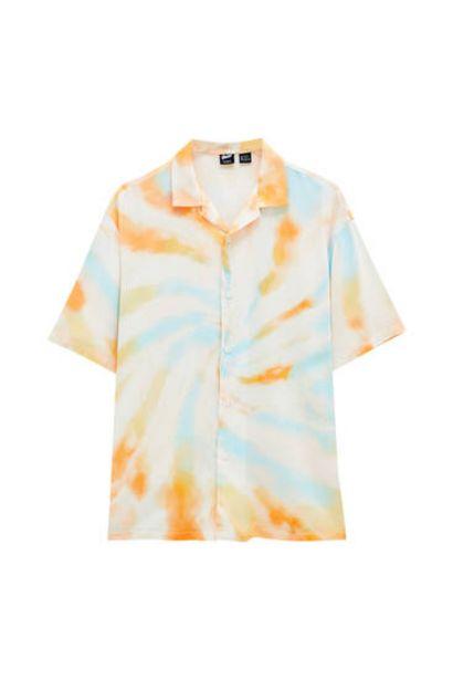 Oferta de Camisa tie-dye tonos naranjas por 9,99€
