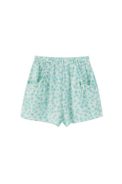 Oferta de Short estampado bolsillos lazos por 9,99€