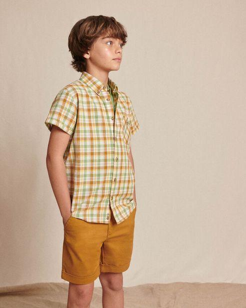 Oferta de Pantalón chino corto de niño en color marron. por 19,5€